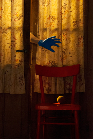 Hand with blue glove reaching out door